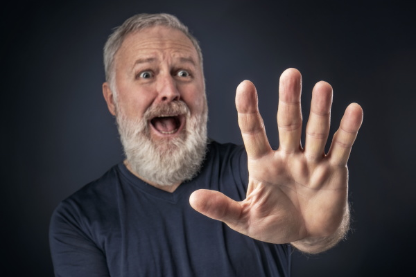 panicked, old, man, with, his, stretched - 23832048