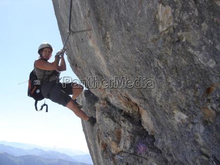 woman sport sports mountains rock rise