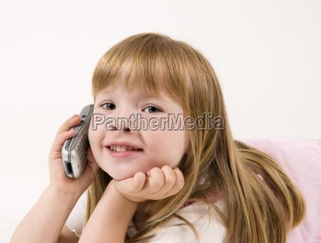 smiling girl at phone