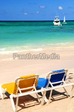 chairs on sandy tropical beach
