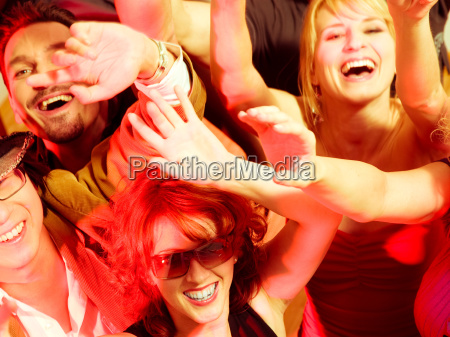 cheering crowd in club or disco