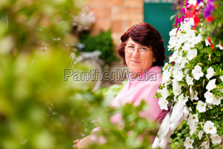 woman with flowers in her garden