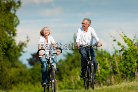 happy couple riding a bike in