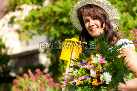 gardening in summer woman with
