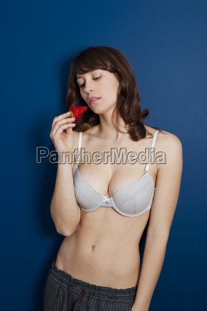 beautiful woman eating a strawberrie