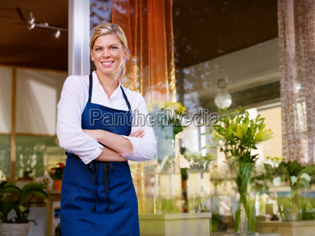 young pretty woman working as florist