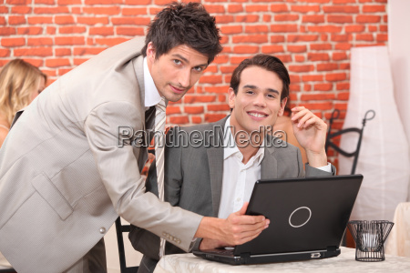 handsome young men working at a