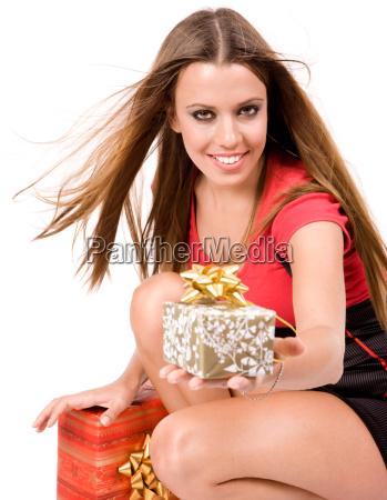 beautiful shopping girl giving gift box