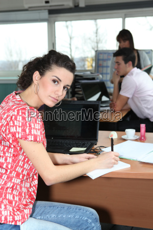 woman glancing up from her desk