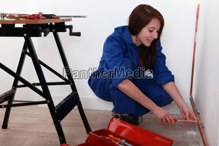 young trainee plumber
