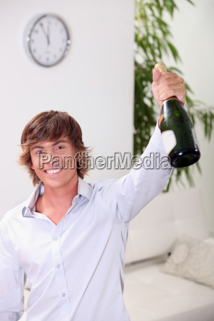 man holding bottle of champagne
