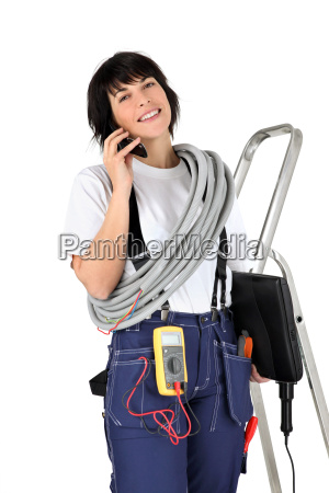 female electrician making telephone call