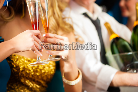 a couple with champagne in club