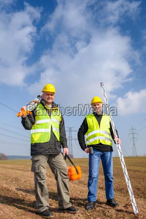 geodesist two man equipment on construction