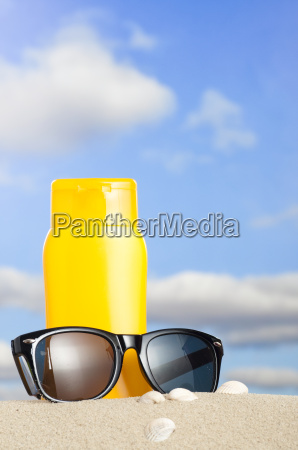 tube with sun protection and sunglasses