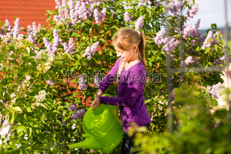 happy child is pouring flowers in