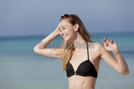 young woman with bikini laughing on