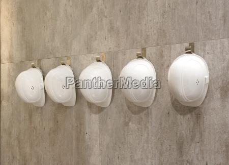 protective helmets on a wall
