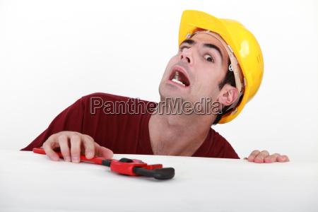 plumber grimacing