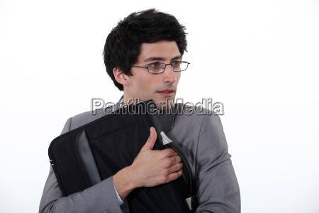 businessman holding a precious briefcase