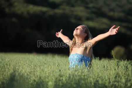 beautiful teenager girl breathing happy in