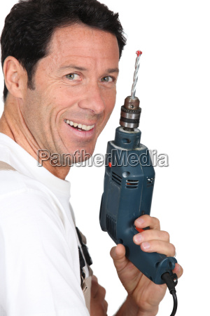 smiling man holding an electric power