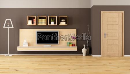 sala de estar marrom com tv