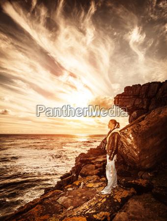 traveler girl on the cliff