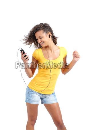 happy teenager girl dancing and listening