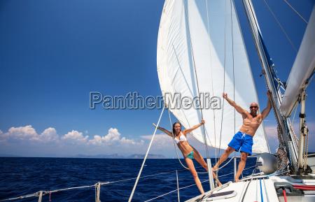 happy couple on sailboat