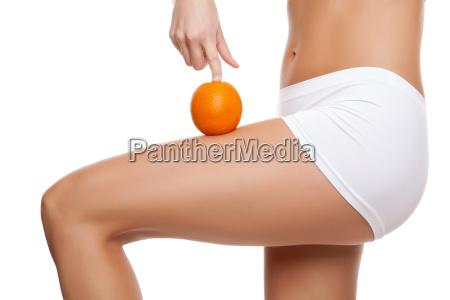 mulher pernas laranja pele dieta magro