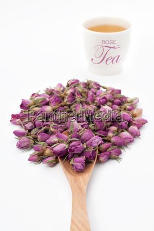 flor de rosa com um copo