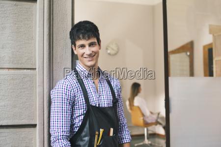 portrait of man working as hairdresser