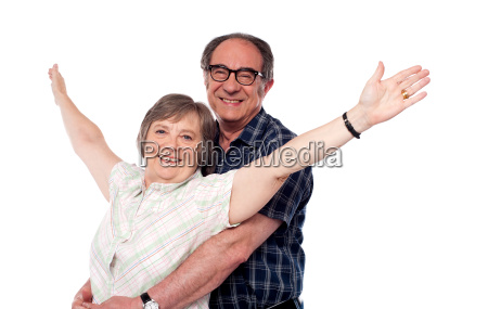 mature woman with arms outstretched