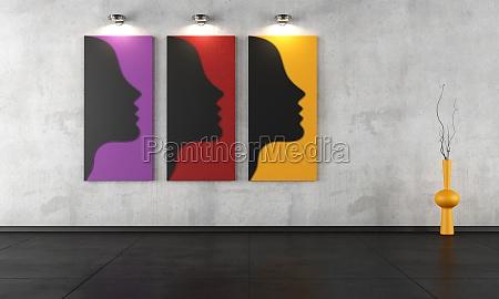 tres pinturas contemporaneas em um quarto