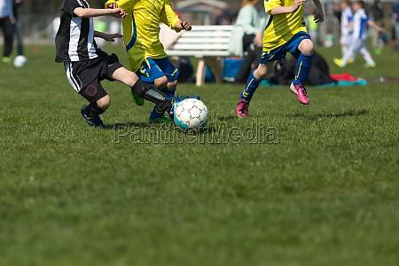 tres jogadores de futebol