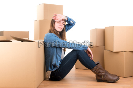 tired girl with boxes