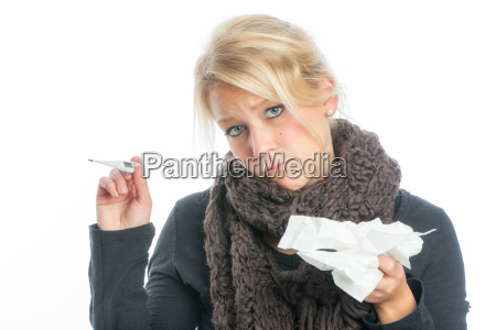 sick woman with fever thermometer