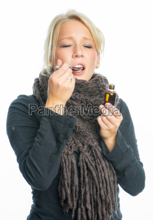 sick woman with cough drops