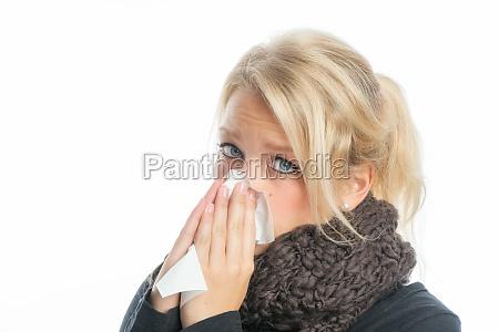 sick blonde woman with handkerchief