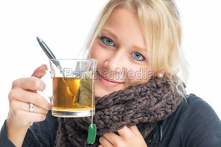 frau with tea glass