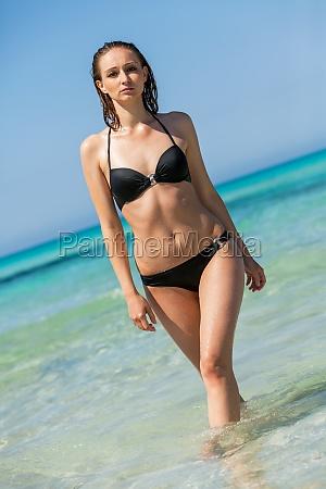 young female model with black bikini