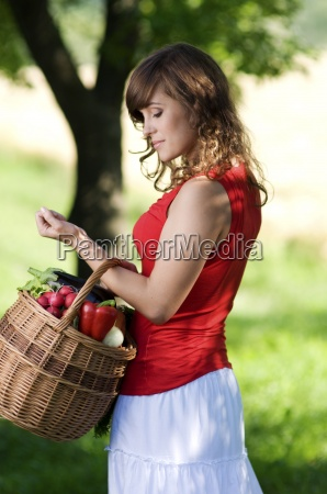young woman with basket filled fresh