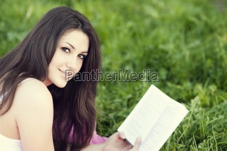 young woman reading a book on