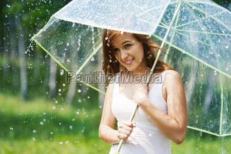 beautiful woman with umbrella during the