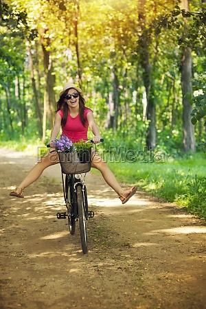 happy woman enjoying a cycle ride