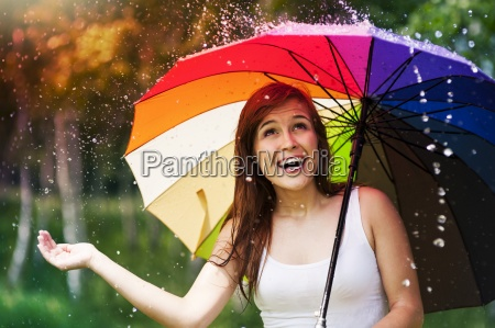 surprised woman with umbrella during summer