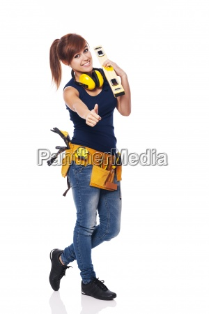 young female construction worker showing ok