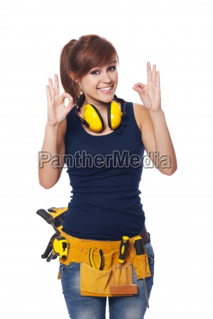 happy young female construction worker gesturing