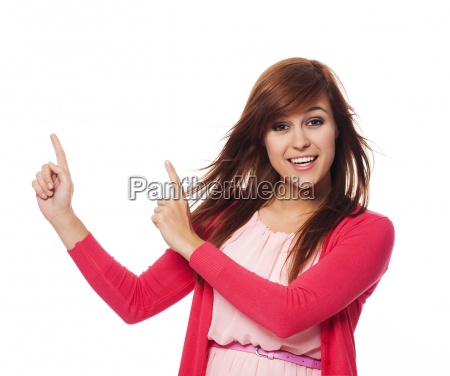 beautiful woman in pink pointing at